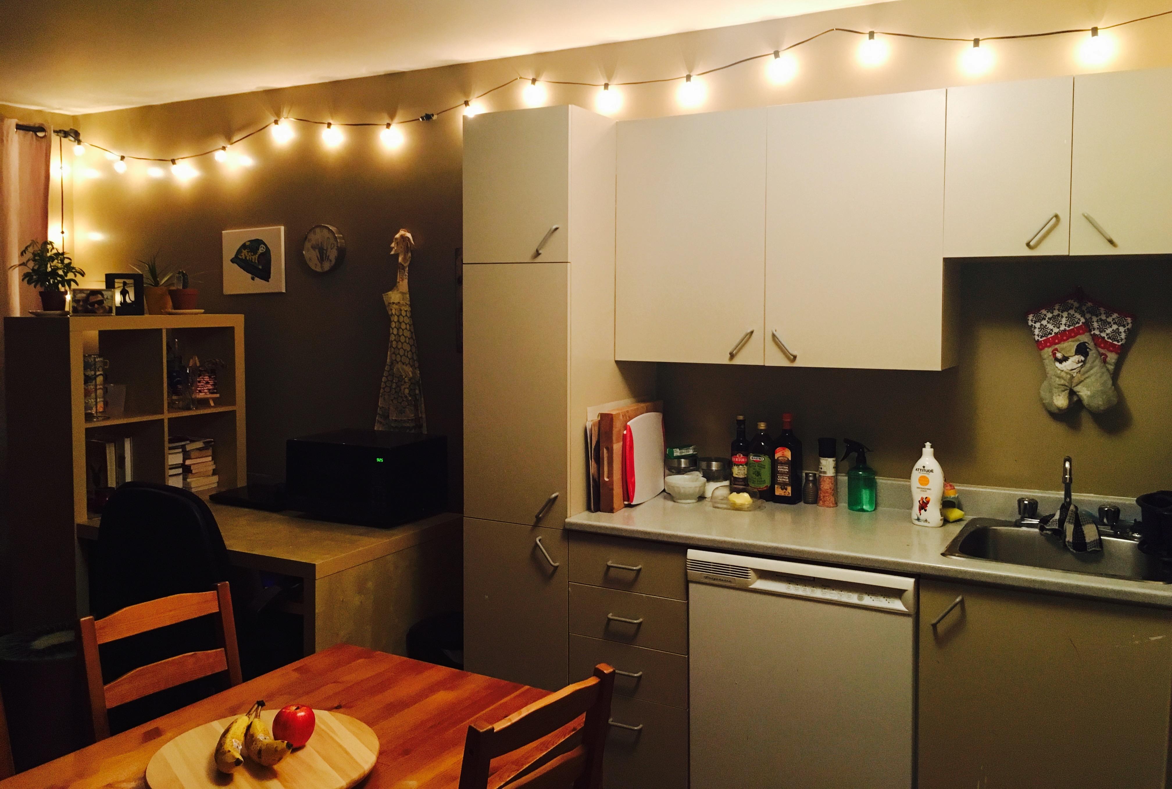 String lights hung along kitchen walls
