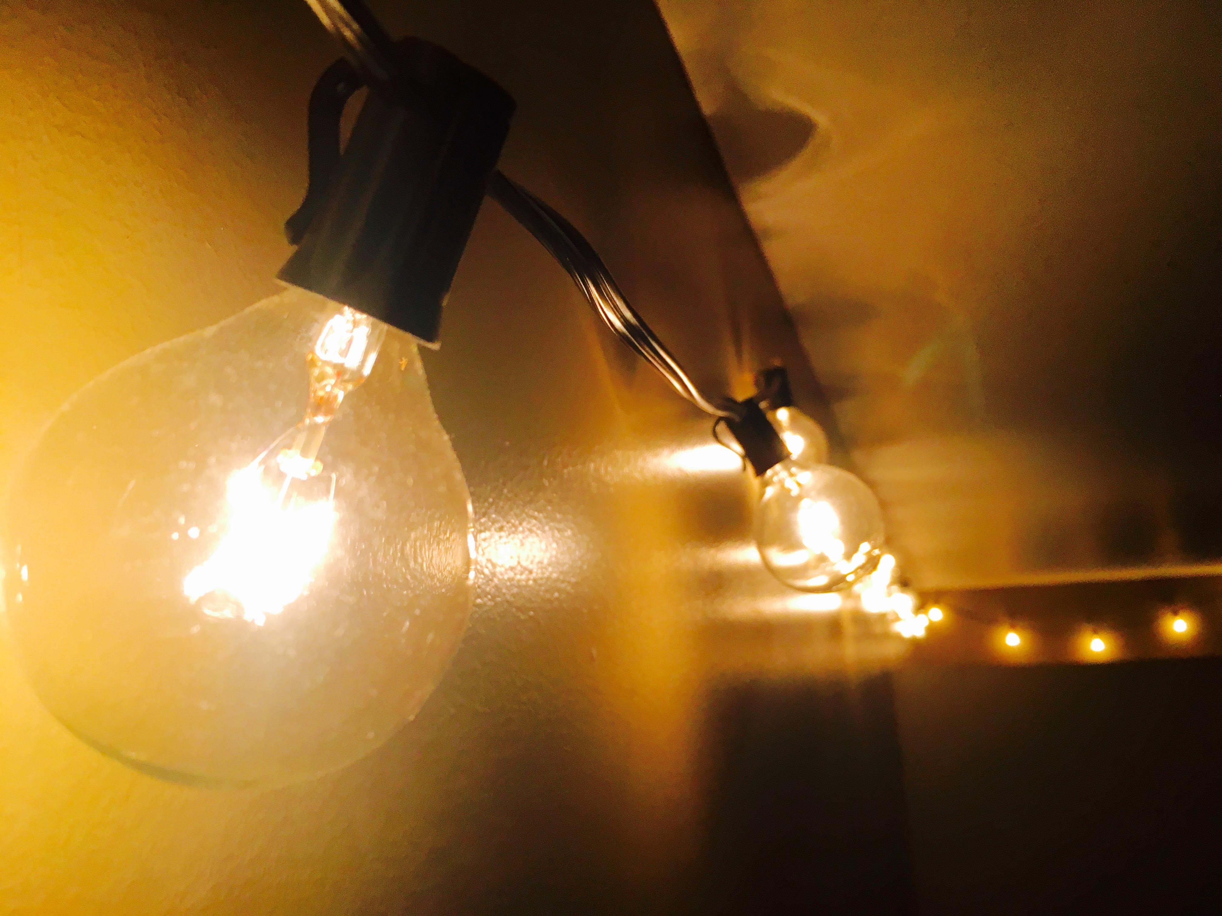String lights hanging along wall